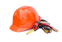 Protective construction helmet and tools Stock Images