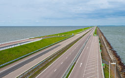Protective Dam. Modern Highway on the Protective Dam in Netherlands Royalty Free Stock Images