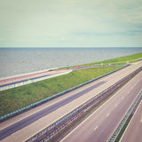 Protective Dam. Modern Highway on the Protective Dam in Netherlands, Retro Effect royalty free stock photography