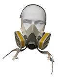 Protective dust mask. Plastic mannequin wearing protective dust mask with valve isolated on white stock photo