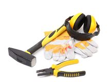 Protective ear muffs gloves and tools Stock Photos