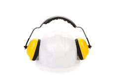 Protective ear muffs and hard hat. Royalty Free Stock Images