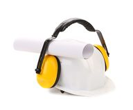 Protective ear muffs and hard hat paper roll. Stock Photography