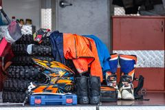 Protective equipment for motorsport, background. Protective equipment for motorsport with spare parts stacked in a van, background stock photography