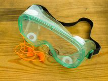 Protective eyeglasses and ear plugs Stock Image
