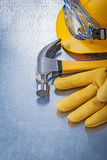 Protective eyewear building helmet safety gloves claw hammer con Royalty Free Stock Photo