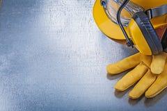 Protective eyewear building helmet safety gloves earmuffs constr Stock Photos