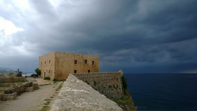 A protective fortress in Rethymno on the beach in rainy weather Stock Images