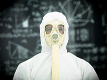 Protective geared person in front of blackboard Royalty Free Stock Photos