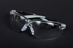 Protective glasses on a black fabric Stock Images
