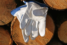 Protective gloves. And Wood background Royalty Free Stock Images