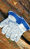 Protective gloves. And Wood background Royalty Free Stock Photography