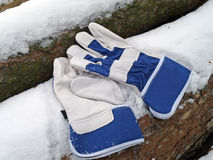 Protective gloves. And Wood snow background Stock Photo