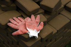 Protective gloves. Red protective gloves on the bricks Stock Photography