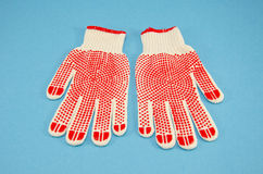 Protective gloves on azure background Stock Photography