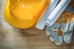 Protective gloves building helmet construction plans Royalty Free Stock Photo