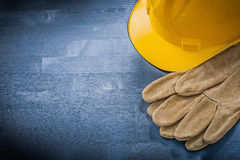 Protective gloves building helmet on wooden board construction c Stock Image