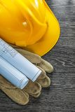 Protective gloves construction plans building helmet on wooden b Royalty Free Stock Photos