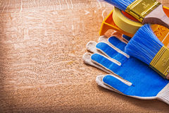 Protective gloves duct tape paint tray and brushes Stock Photo
