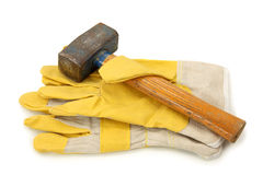 Protective gloves and hammer stock image