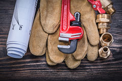 Protective gloves monkey wrench construction drawings brass plum Royalty Free Stock Image