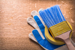 Protective gloves paint brush and duct tape on Stock Image