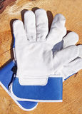 Protective gloves. White and blue protective gloves on Wood Royalty Free Stock Photo
