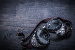 Protective goggles on vintage wood board Royalty Free Stock Photography
