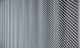 Protective grid. Side view to an metal mesh guard Stock Photography