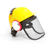 Protective helmet, earmuffs and face shield. Stock Photography