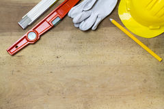 Protective helmet, mason tools  on wood background Royalty Free Stock Images