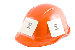 Protective helmet and note stickers. On the white background Stock Photos