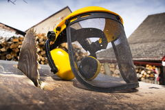Protective helmet on switched off old rusty circular saw Royalty Free Stock Image