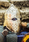 Protective helmet with a visor on medieval knight Royalty Free Stock Photos