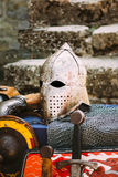 Protective helmet with a visor on medieval knight Royalty Free Stock Image