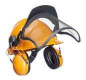 Protective helmet in white back. A orange protective helmet with ear- and face- protection. Studio shot in white back Royalty Free Stock Images