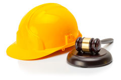 Protective helmet with wooden judge gavel near it Stock Image