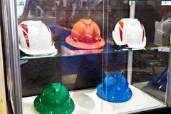 Protective helmet for workers in store. Protective helmet for construction workers in the storefront royalty free stock image
