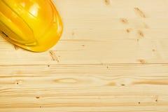 Protective Industrial Helmet on Wooden Background Stock Photos