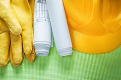 Protective leather gloves building helmet engineering drawings o Stock Image