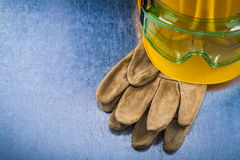 Protective leather gloves yellow building helmet and plastic saf Royalty Free Stock Photo
