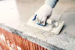 Protective material against water on house building. worker waterproofing cement Stock Image