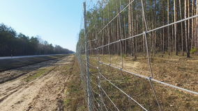 Protective mesh on the side of the road from wild animals stock video footage