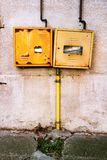Protective metal box of gas meter. On the wall of the house royalty free stock photo