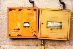 Protective metal box of gas meter. On the wall of the house royalty free stock images