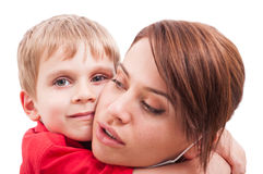 Protective mother hugging happy son Royalty Free Stock Image