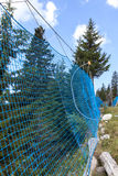 Protective network to the alpine skiing track Royalty Free Stock Photography
