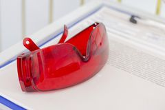 Protective red glasses UV protection in cosmetology dentistry laser depilation stock images
