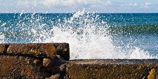 Protective sea wall. Wave crashing against a protective sea wall on Maui, Hawaii Royalty Free Stock Photography