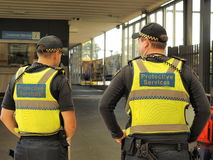 Protective Services officers at a train station Stock Image